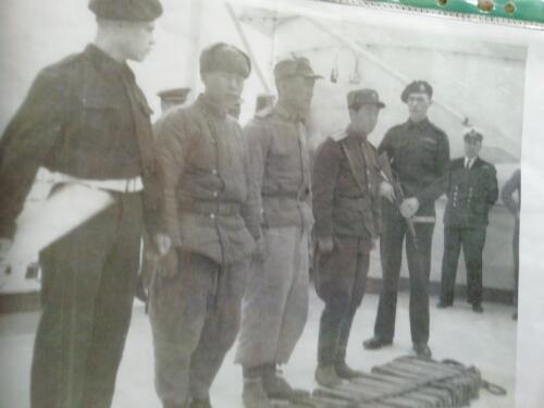 HMS Belfast with captured North Korean prisoners