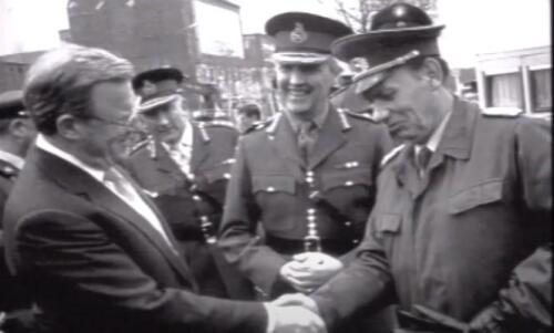 With UK Defence SecretaryTom King and East German border guard.