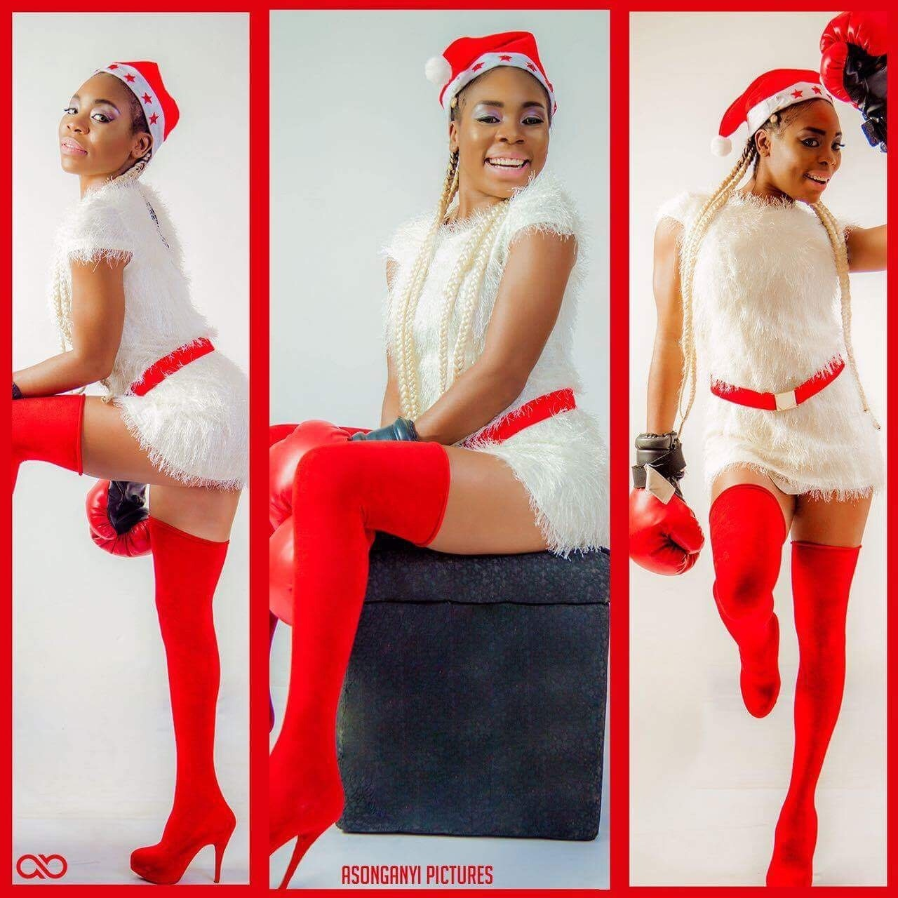 ASKIA POSES IN SEXY RED OUTFIT AS ELF FOR CHRISTMAS