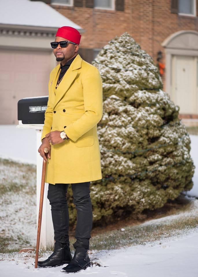 Cameroonian Designer Stanlo Akisa Looks Dashing In Dandy Yellow Coat