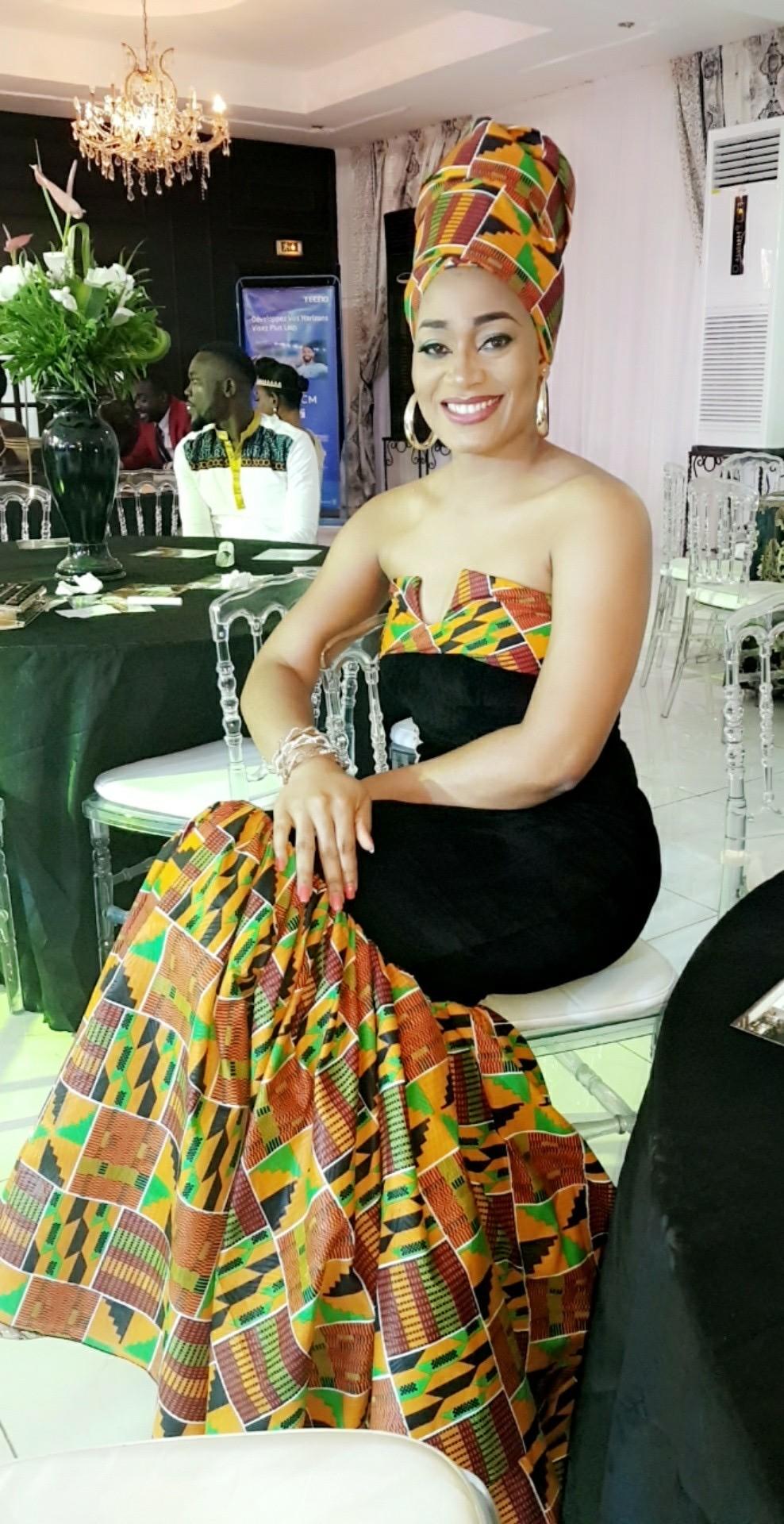 Stephanie Tum Rocks OZI Strapless Kente Dress To Cameroon Fashion Awards