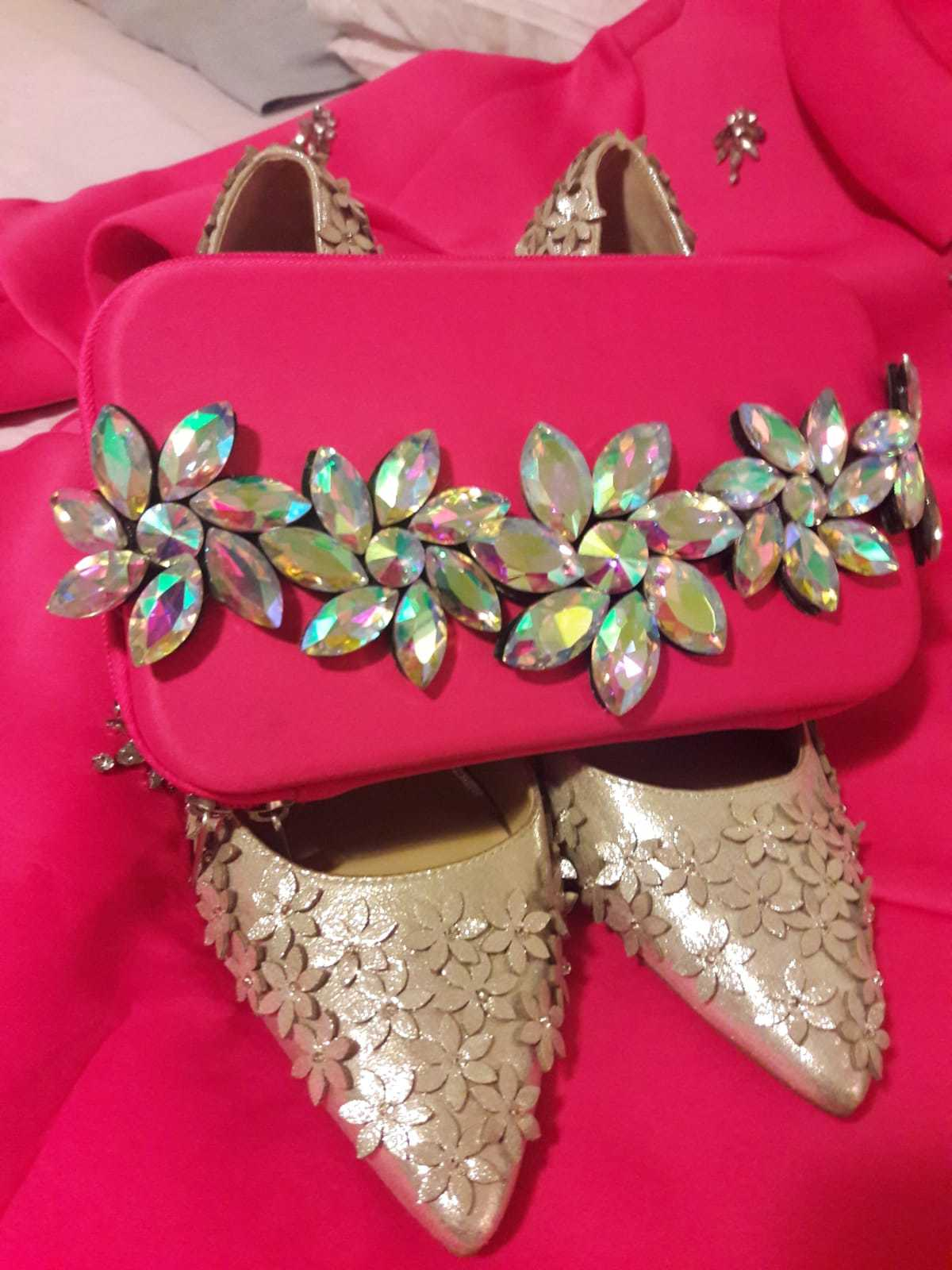 Pink dress and matching clutch and shoes