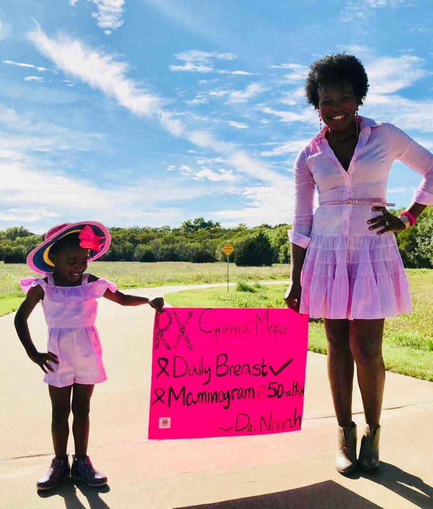 Mother and daughter in pink for breast cancer