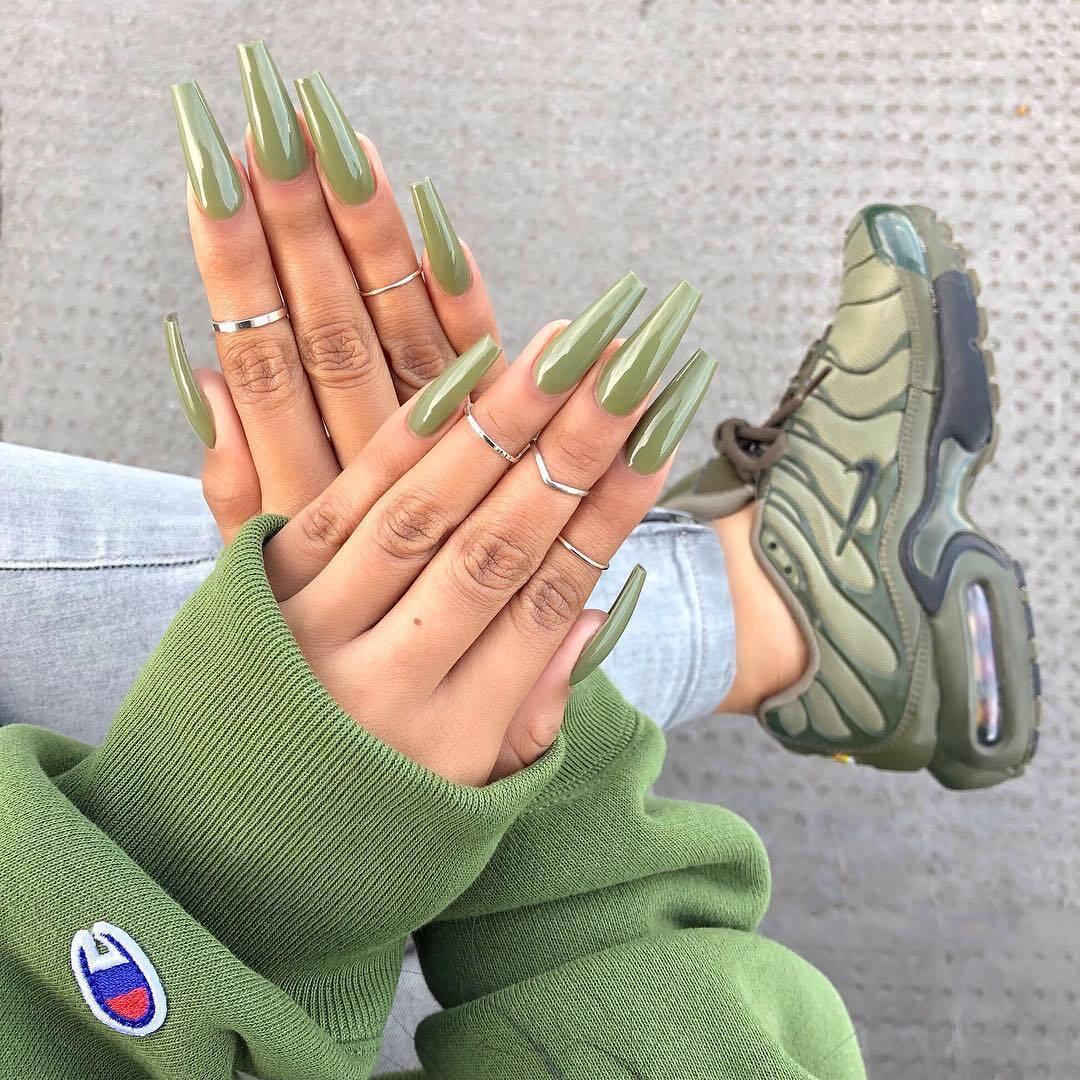 Green nail polish and Green Nike Sneakers