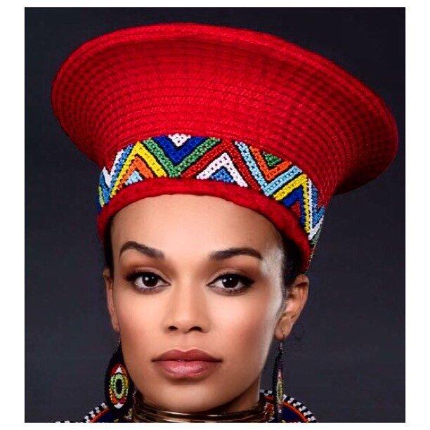 Pearl Thusi In Zulu Elaborate Red Hat