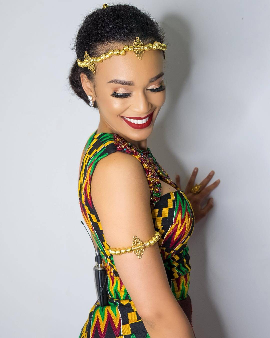 Pearl Thusi in Kente dress and beaded accessories