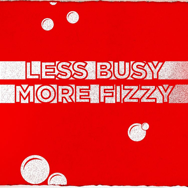 """Text outlined in red over white bars on a red background with white bubbles: """"LESS BUSY, MORE FIZZY."""" From Coca-Cola's Instagram page."""