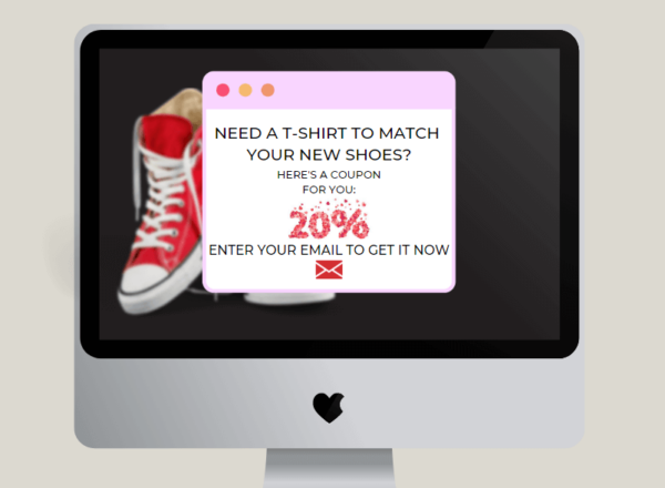 Image on an iMac desktop of a pop-up banner advertisement commonly found on websites and offering a discount to tempt customers.