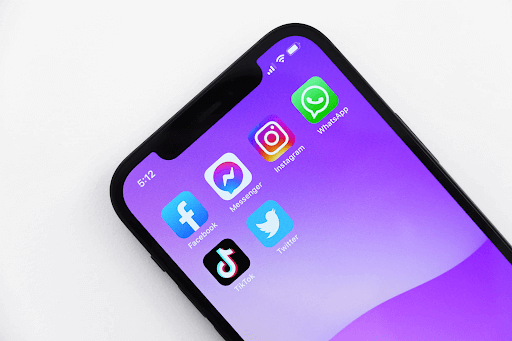 An iPhone screen showing social media apps, such as Facebook, Instagram and TikTok.
