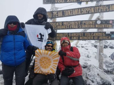 people standing on Kilimanjaro with flags
