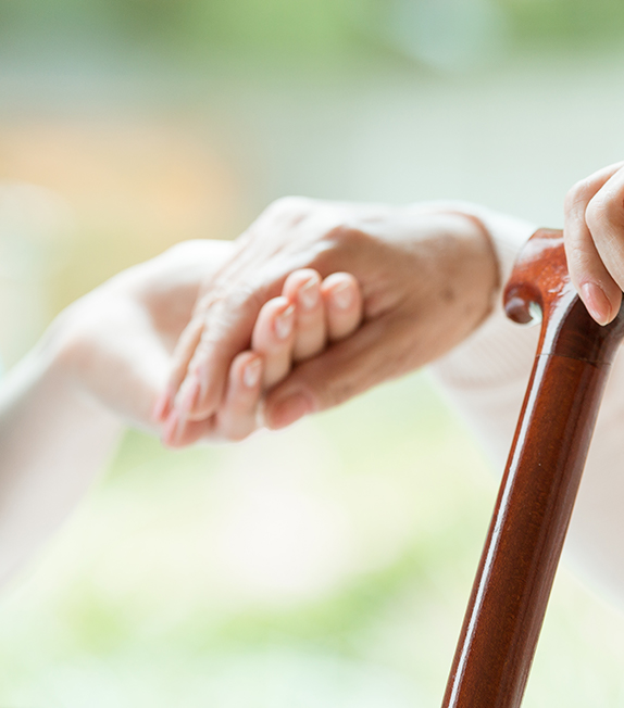 Elderly person with a walking stick