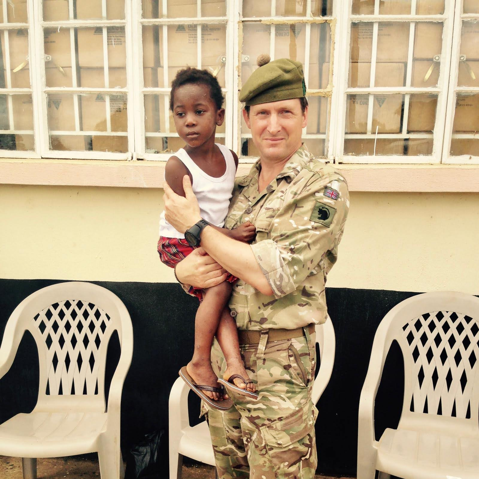 Maj Gen (Retd) Herbert with Child in Sierra Leone