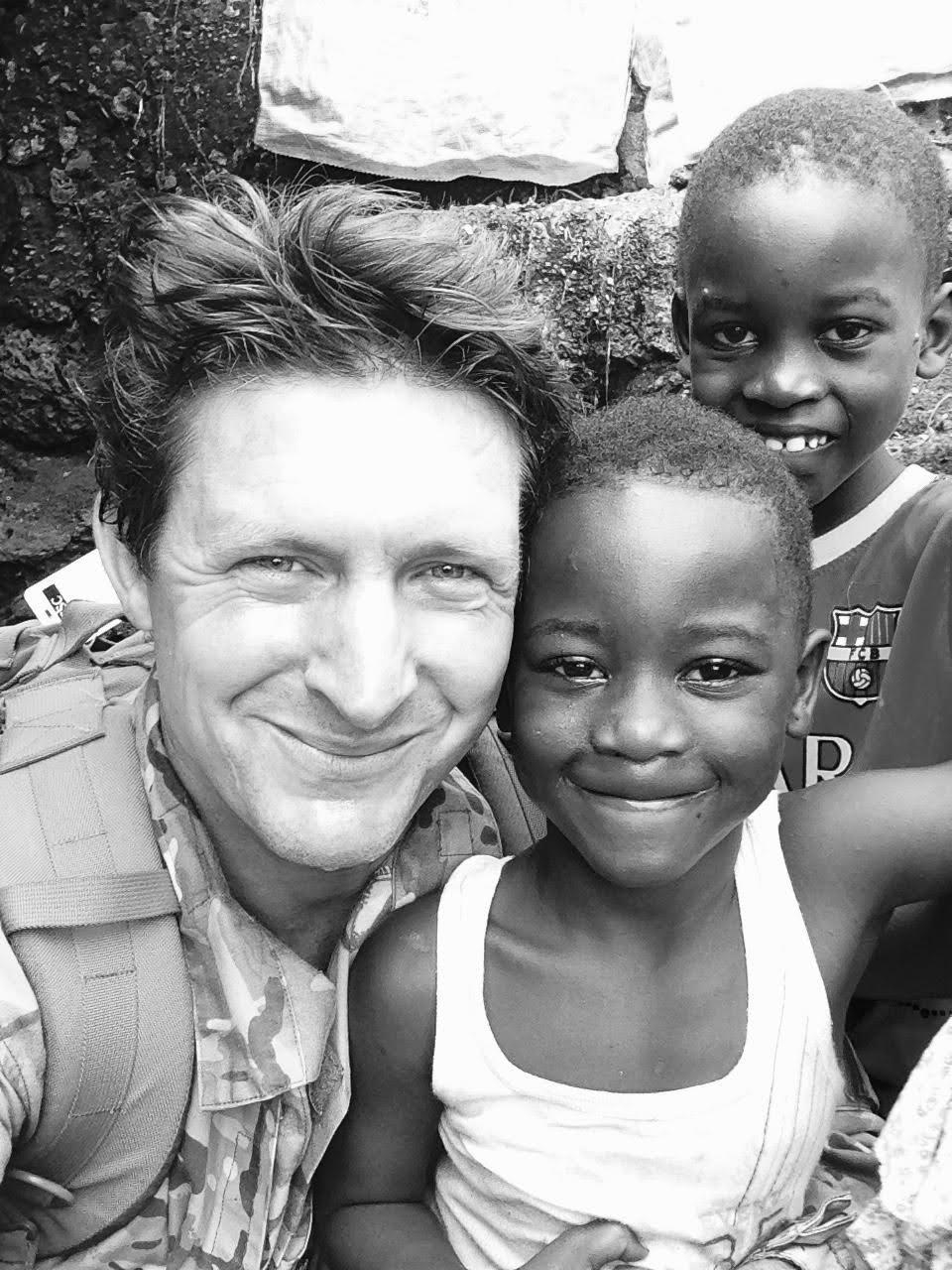 Maj Gen (Retd) Charlie Herbert with children in Sierra Leone