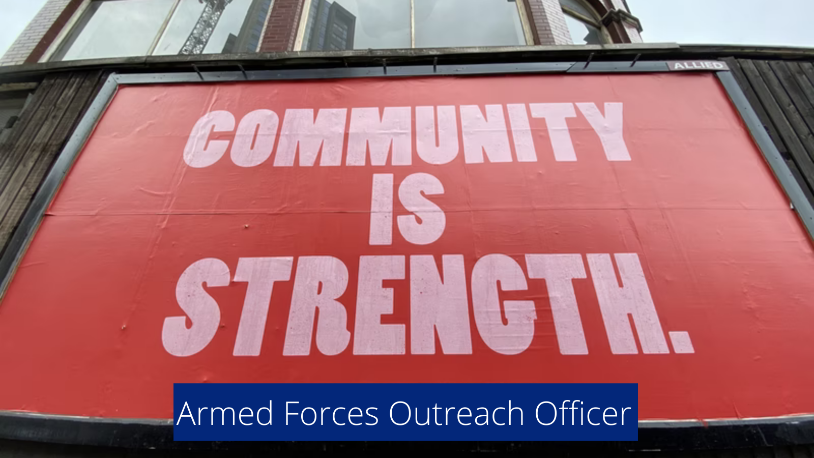 Large billboard sign that says community is strength