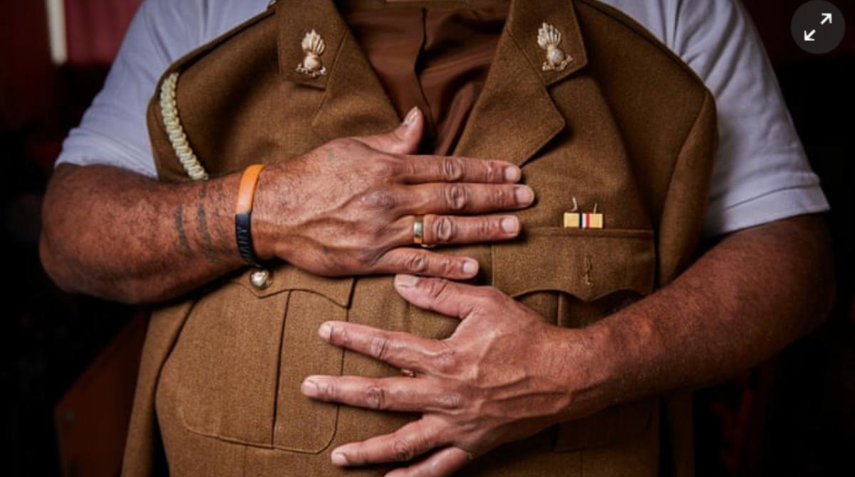 Fijian vet holding number 2 military dress