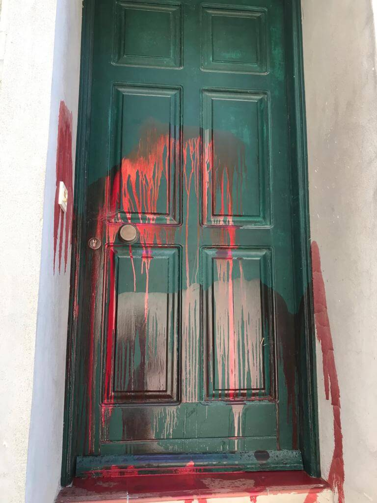 17: The doorway of a refugee support worker in Greece which has been vandalised with paint