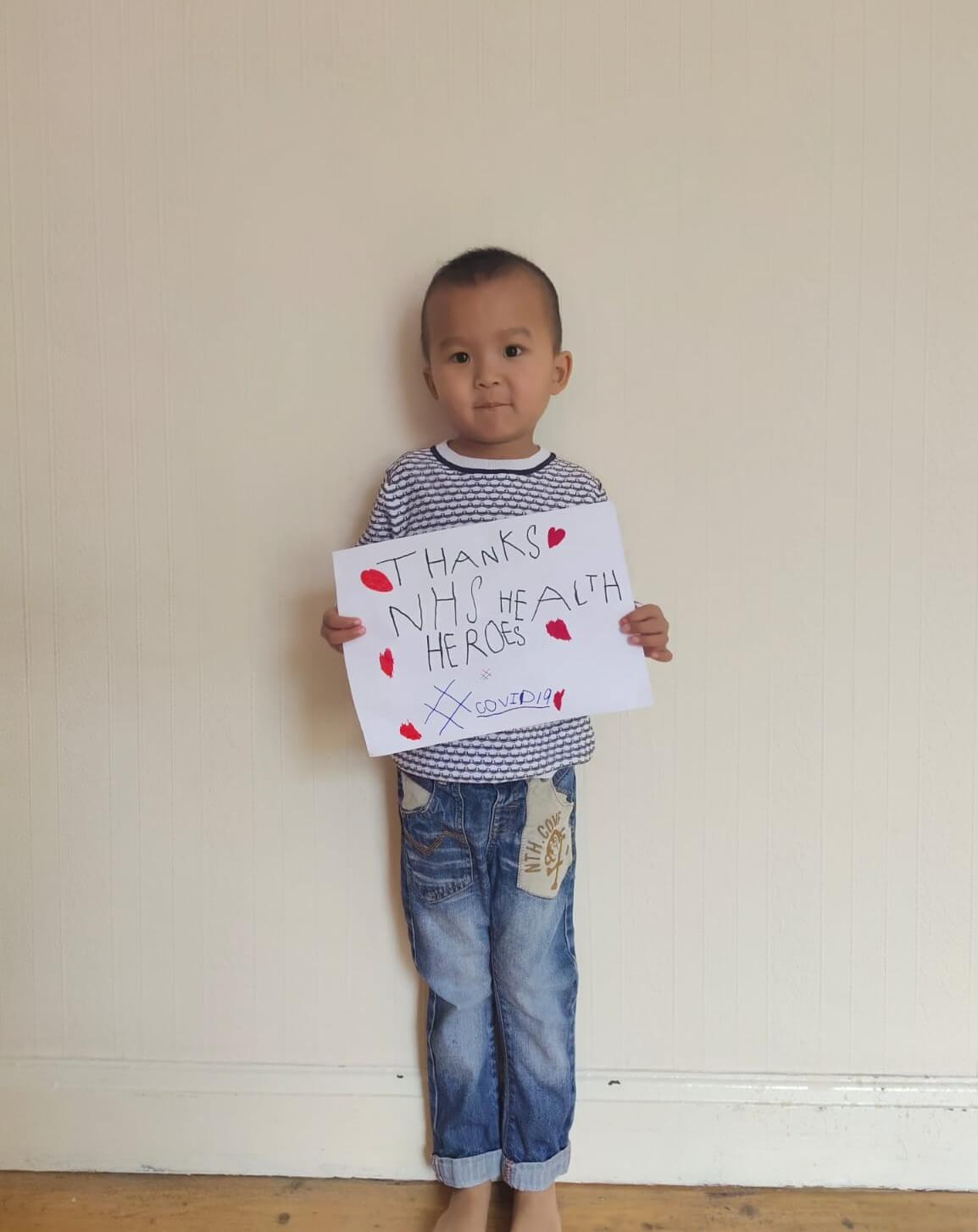 01: A young boy showing his support for the NHS
