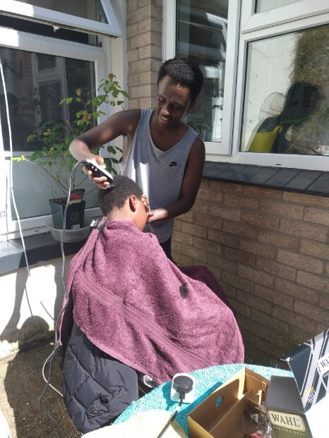 07: A Kenyan refugee family learning new skills, including hairdressing, and how to work together at home