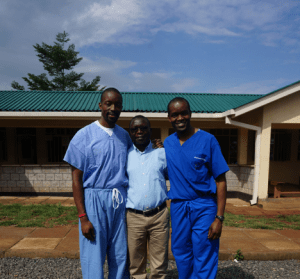 Lwala_Fred-Ochieng-Wycliffe-Omwanda-our-Head-Clinician-and-Milton-Ochieng-stand-in-front-of-the-new-maternal-and-child-health-wing-of-the-Lwala-Hospital-300x279