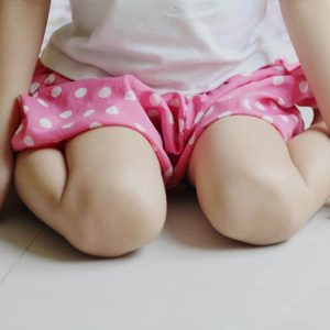 A girl in w-sitting position