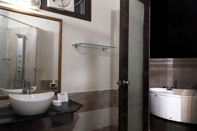 Bathroom with open to Sky Jacuzzi @ Corbett Panorama Resort