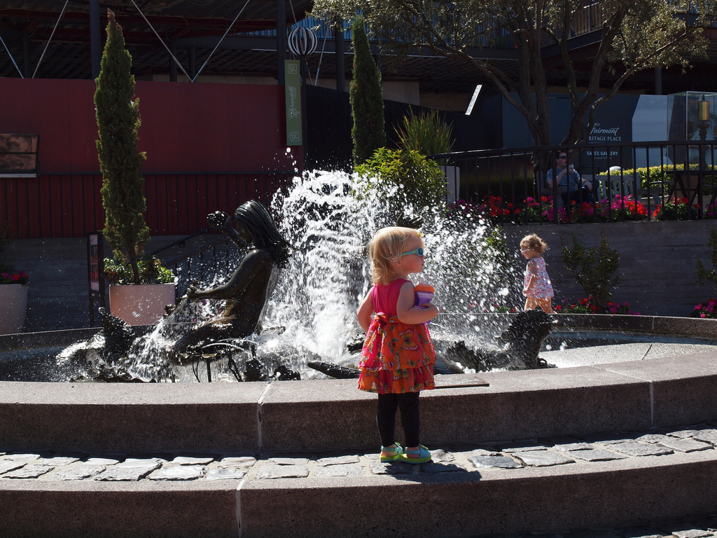 Children playing by the fountain