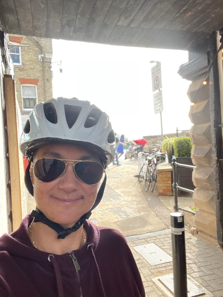 Katie in St Ives, in a cycling helmet
