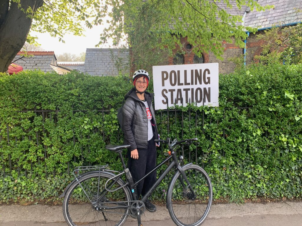 Katie and her bike outside a polling station in Petersfield