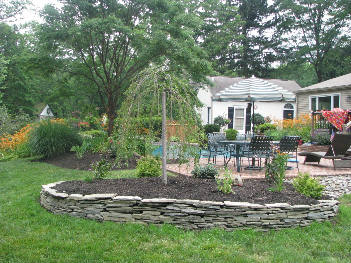 McClintock - snow fountain cherry with natural stone wall2