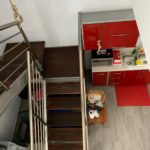 10.- Departamento T - Stairs to second floor
