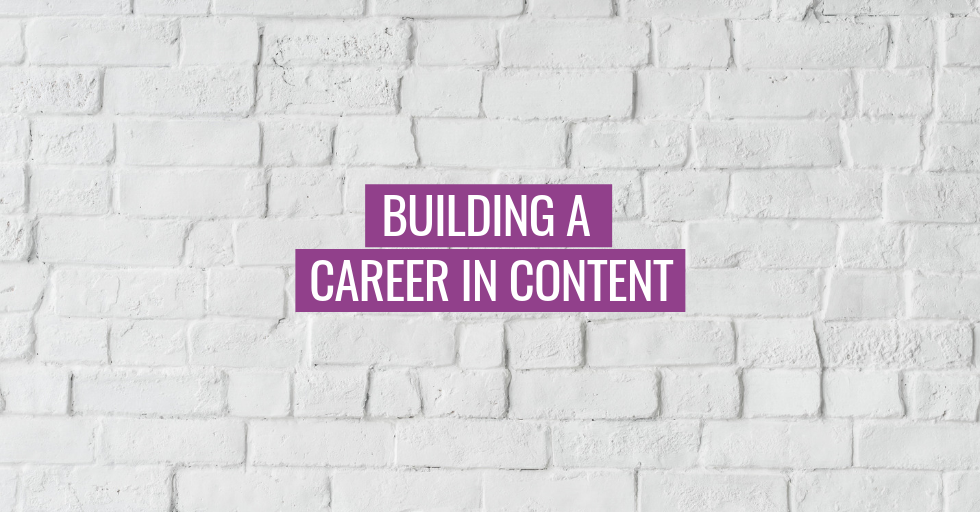 """A white brick wall, with text, """"Building a career in content."""""""
