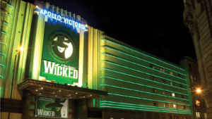 Exterior shot of the Apollo Victoria Theatre in London, where the cast of Wicked and our favourite West end Witches perform 6 nights a week.