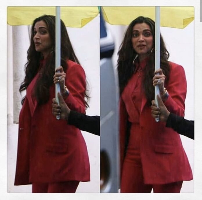 Deepika looks amazing as ever as she is seen wearing a hot pink pantsuit.