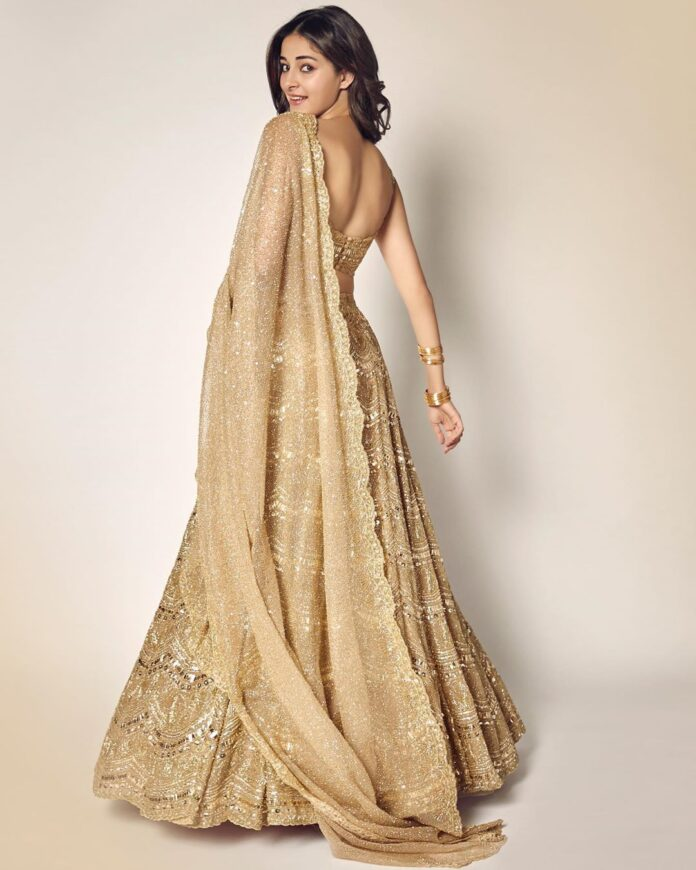 Ananya Panday dazzles in gold lehenga at Armaan Jain's wedding ...
