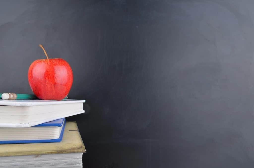 an apple near a chalk board