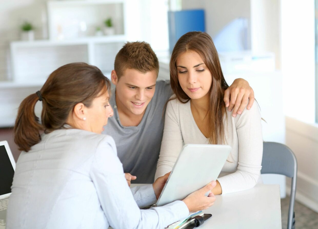 3 people looking at an appraisal