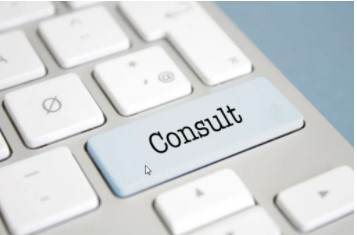 Photo of a computer keyboard with the word CONSULT instead of ENTER.
