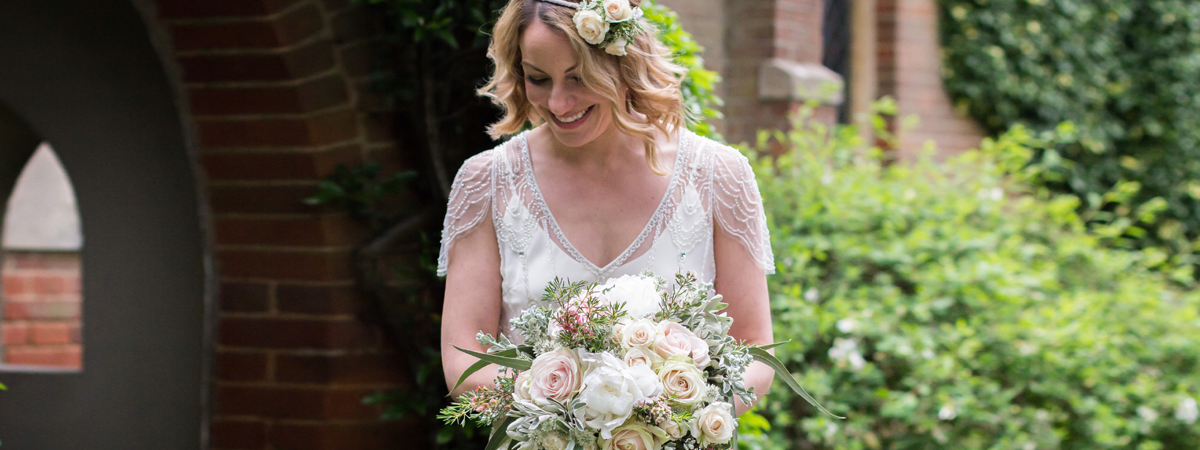 image of a bride with her bouquet and flower crown outside a church
