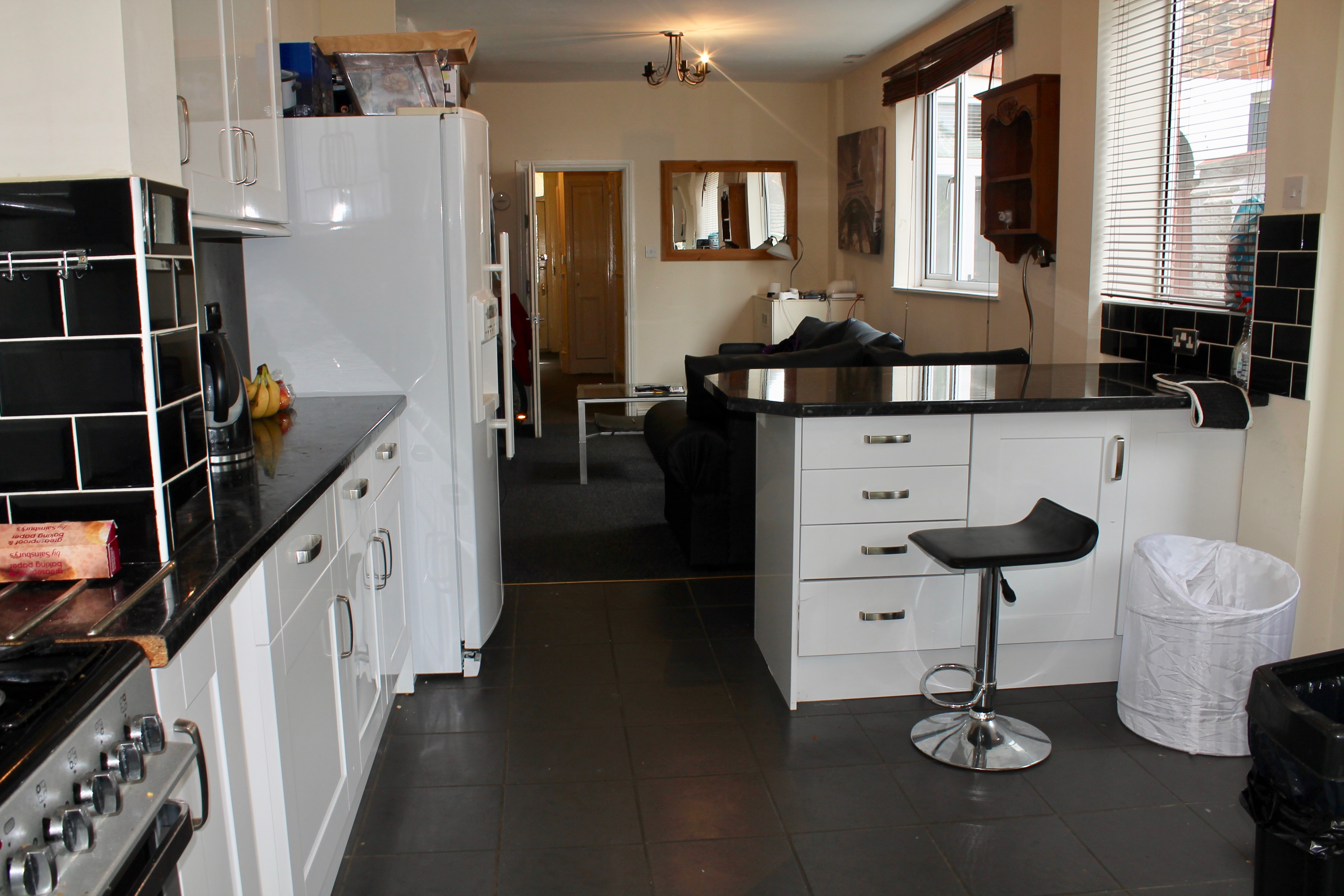 Kitchen in the avenues property which is fully equipped.