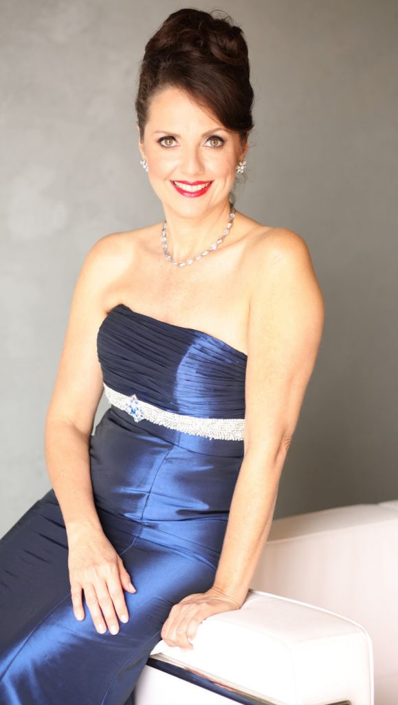 Photo of Elizabeth Montgomery in blue satin dress
