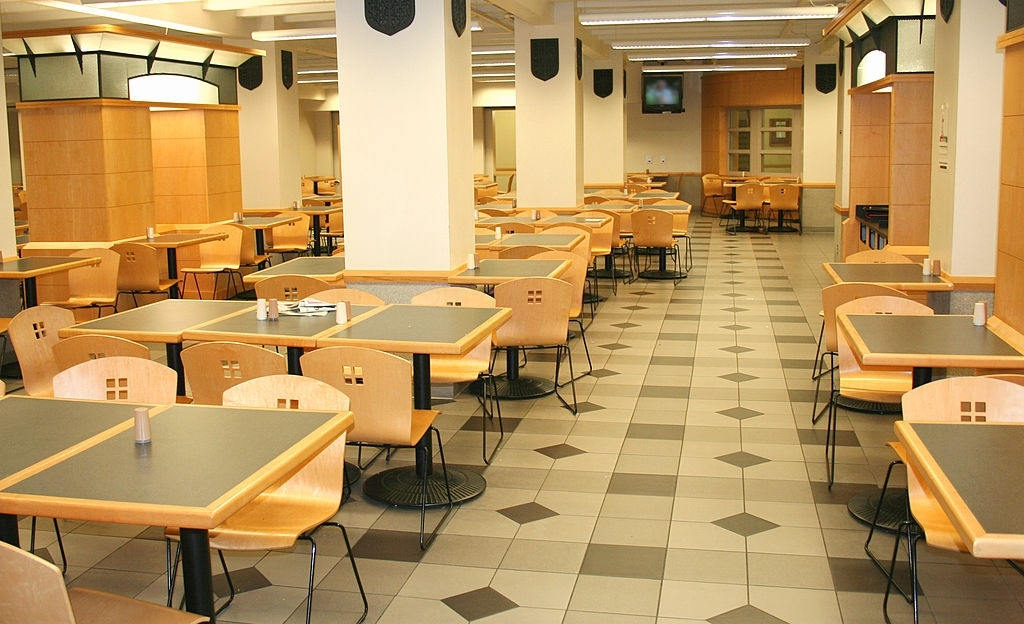 A modern cafeteria waits for people to arrive