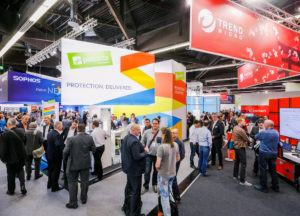 Exhibitors and visitors inside it-sa exhibition