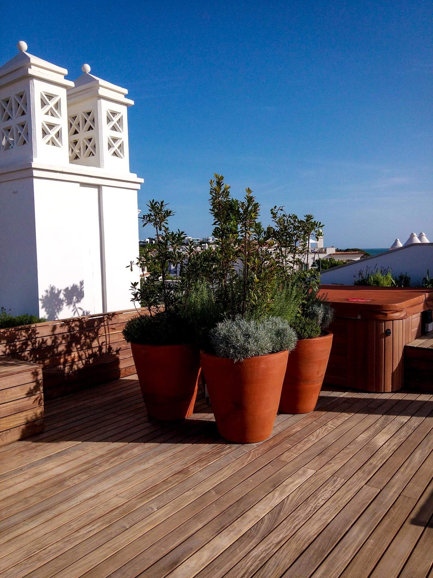 condominium roof terrace with vases