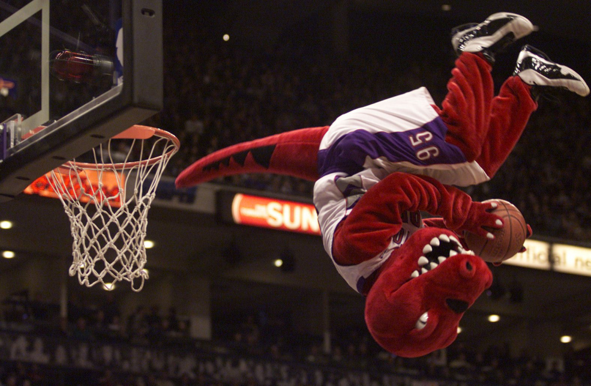 TORONTO OUT RAPTORS03--12/02/01----The Raptor was the only homeside player or mascot to make hoops. The Toronto Raptors had a rough afternoon versus the Boston Celtics in Toronto, December 2, 2001. The Raptors lost 85-69. The raptors only scored nine points in the fourth quarter and shot 31.8 percent from the field. (STEVE RUSSELL/TORONTO STAR) DIGITAL IMAGE POY2001