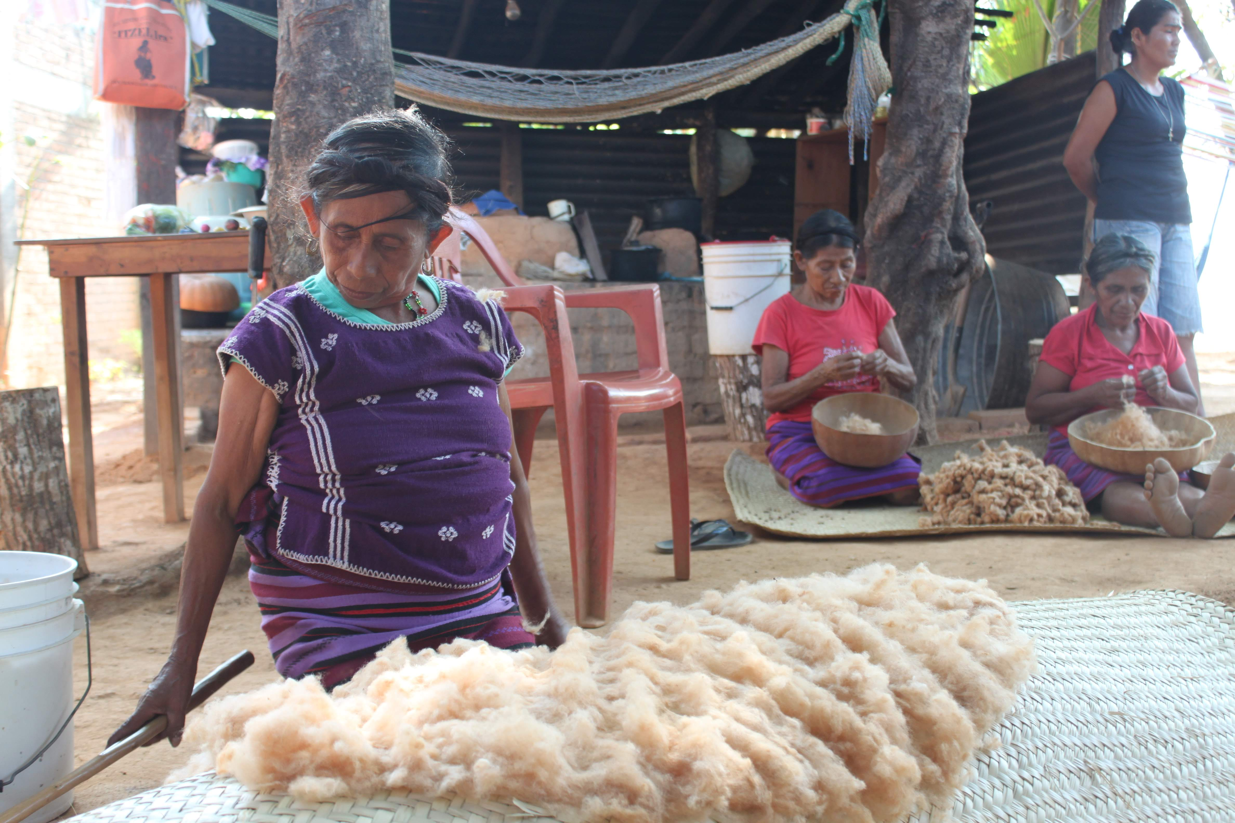 Mexico women work in weaving wool into yarn as part of womens economic empowerment workshops