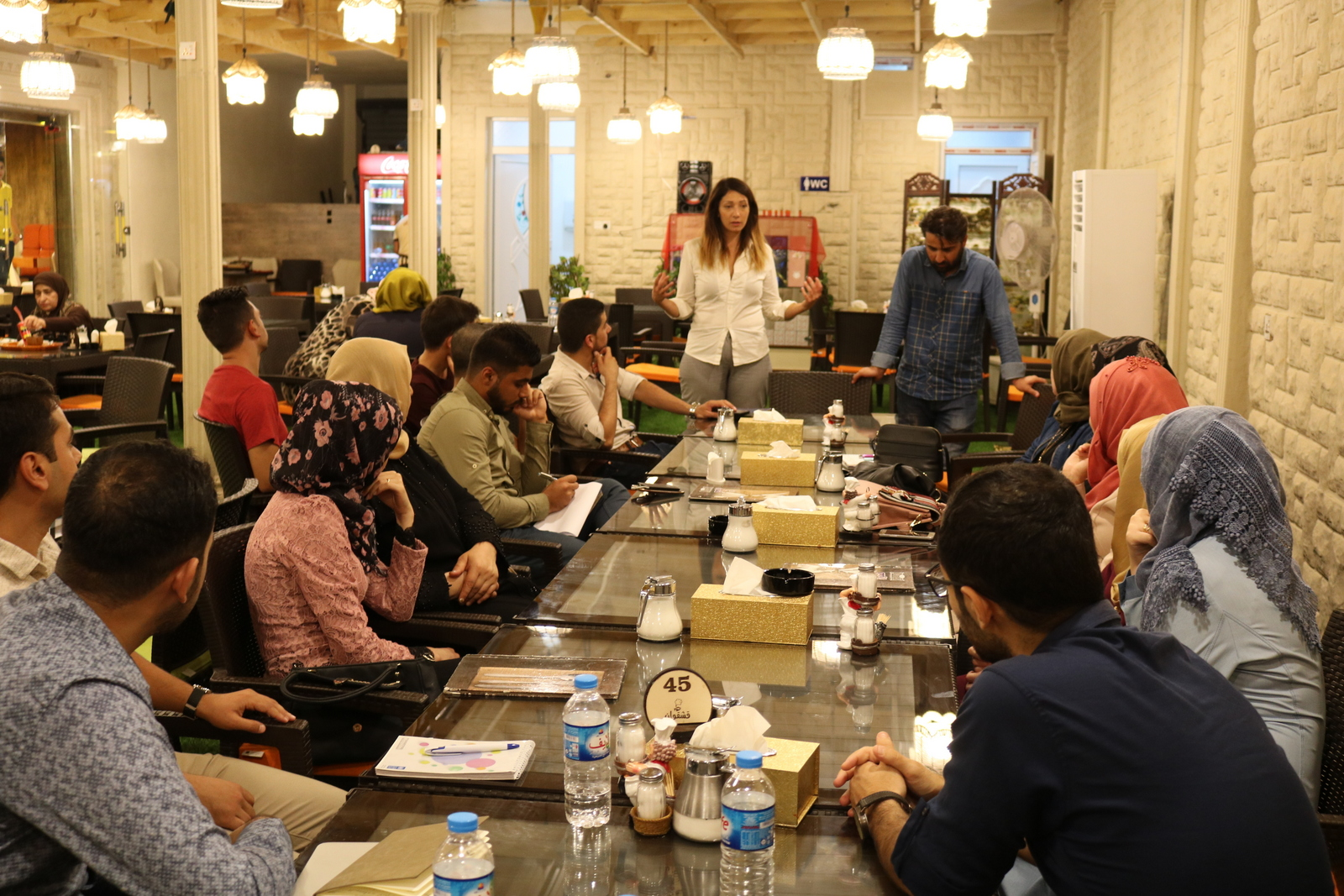 Beatrice Maneshi holds a focus group on entrepreneurship with youth in Mosul in July 2018.