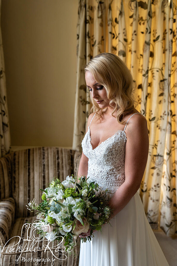 Bride looking at her bouquet