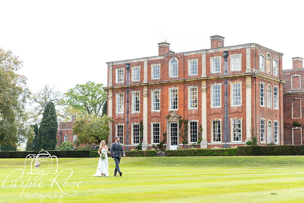 Bride and groom exploring their venues gardens