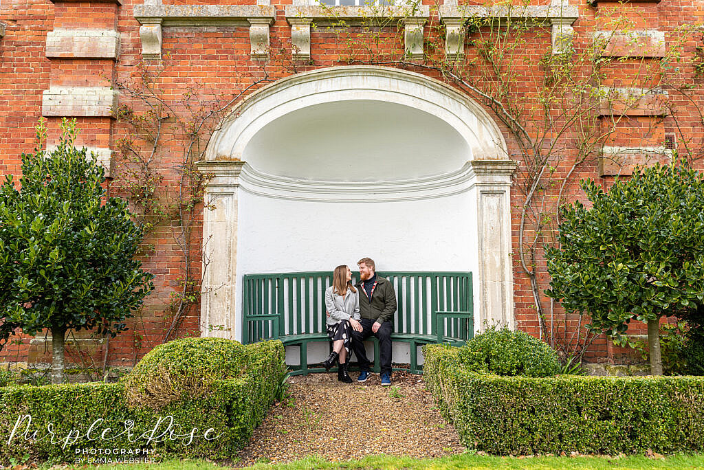 Couple sat on a green bench
