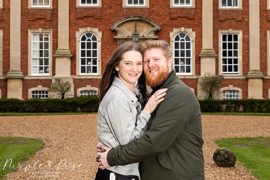 Couple hugging in front of Chicheley Hall